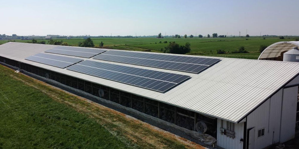 Solar panel installation on the roof of a turkey farm building in Washington, IA