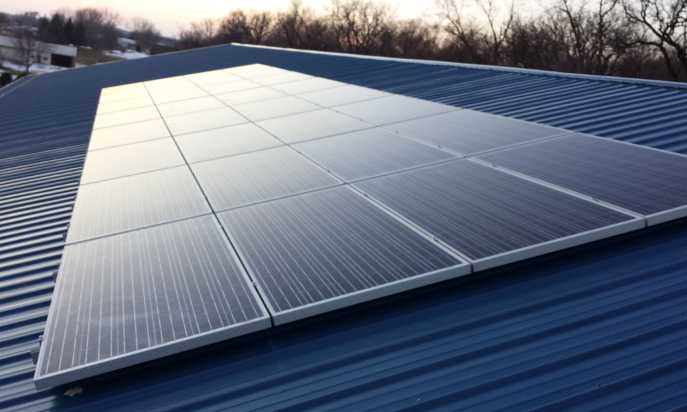 Roof mounted solar panels on Cornerstone Excavating building in Washington, Iowa.