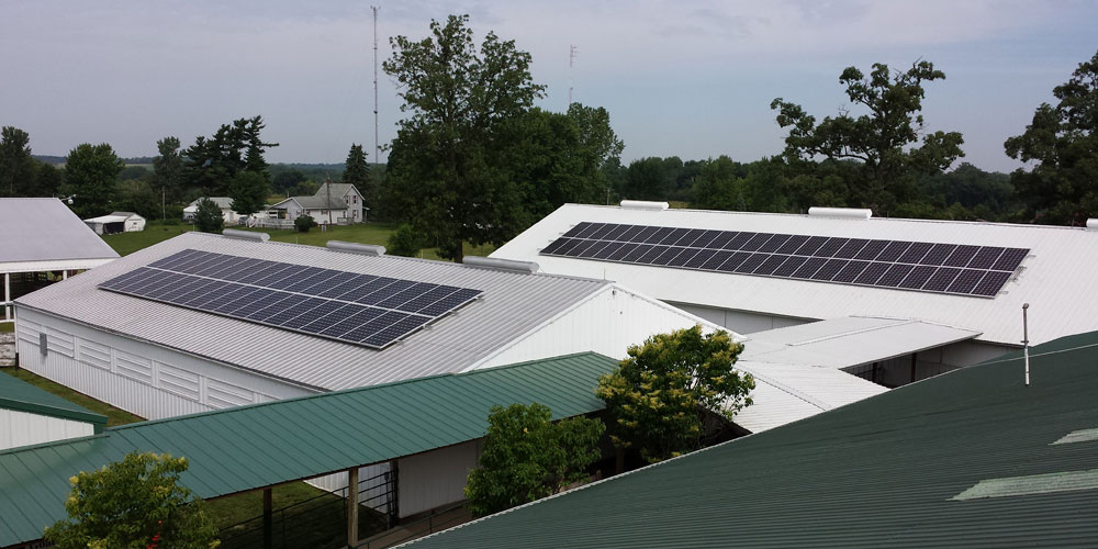 Roof mounted solar panels on Washington County Fairgrounds buildings.