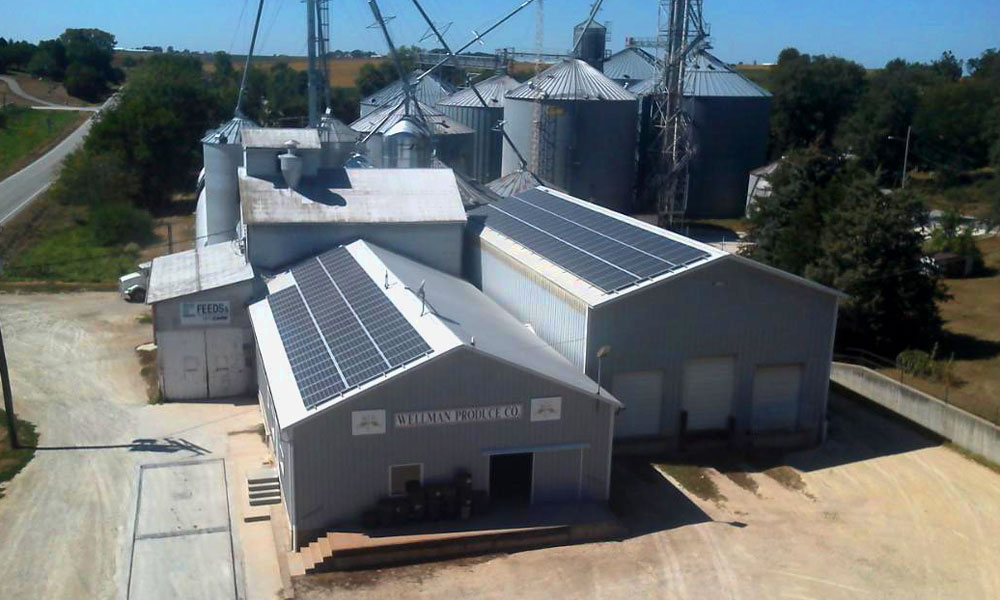 Roof mounted solar panels on Wellman Produce grain elevator.