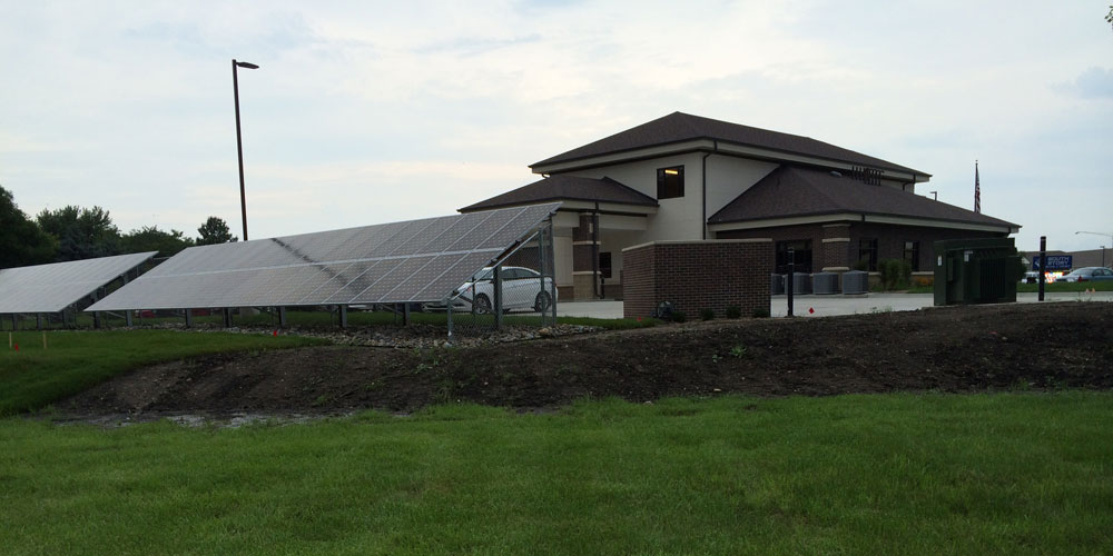 Ground rack solar panel installation powers South Story Bank and Trust of Huxley, Iowa
