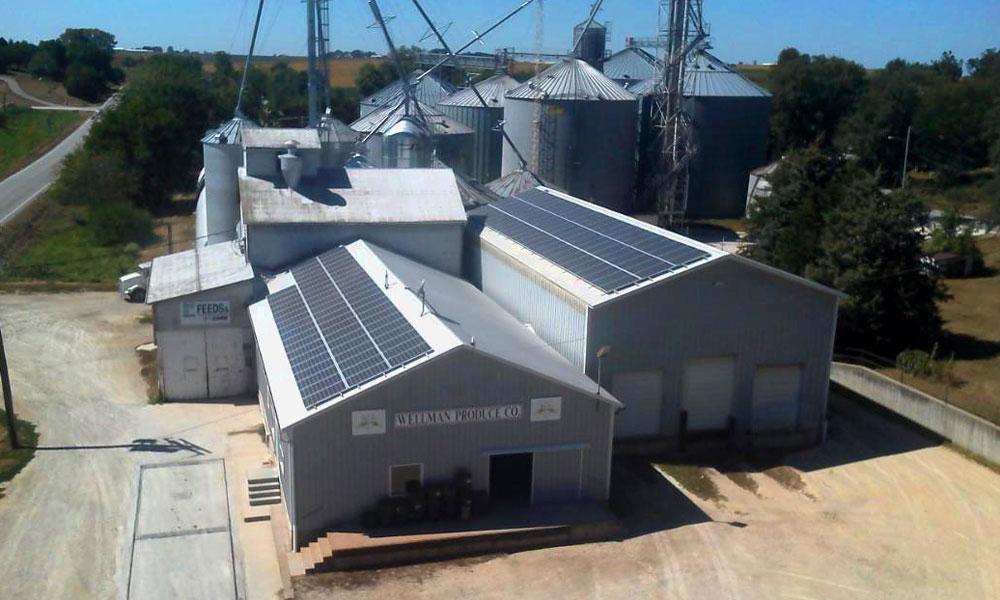 Roof mounted solar panels on Wellman Produce grain elevator, Wellman, IA